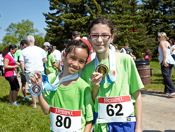 Event photographer THCF Run/Walk May 2014 girls running team with medals