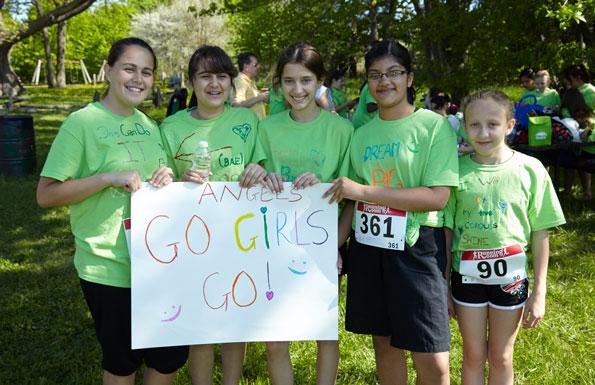 Event photographer Tim Horton Children's Foundation run/walk May 2014 group girls with team sign