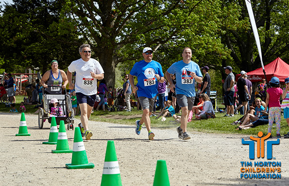 Special Event Photography of adults at finishing line at THCF Run and Walk