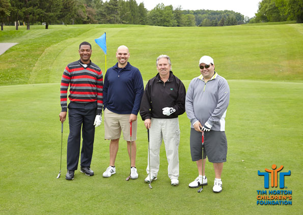 Event photography Tim Hortons golf participants on green